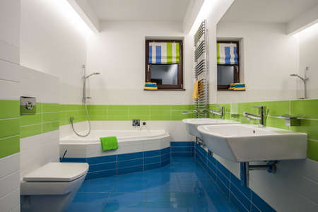 bathroom: Travertine house - green, blue and white colors in bathroom Stock Photo