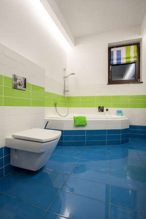 Travertine house - colorful bathroom: green, blue and white tiles photo
