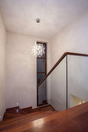 Travertine house - glass staircase with wooden stairs photo
