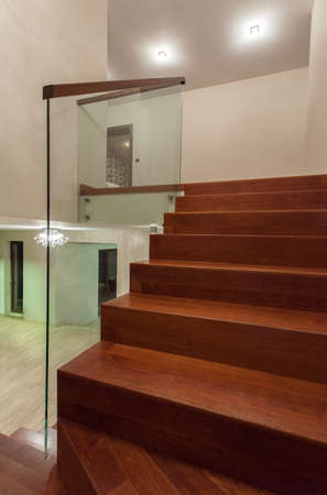 Travertine house - modern designed stairs made with wood and glass photo