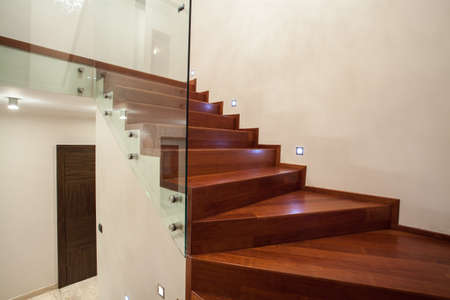 Travertine house - modern glass, metal and wooden staircase photo