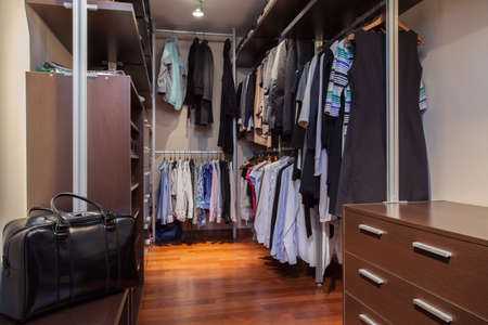 Travertine house - Clothes and shoes in walk-in wardrobe Stock Photo - 16971234