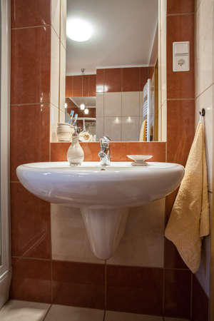 Basin with a rectangular mirror - vertical view photo