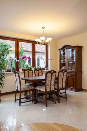 Wooden furniture in the bright dining room photo