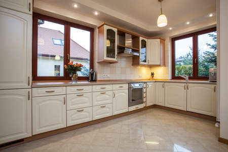 Horizontal view of the beige kitchen photo