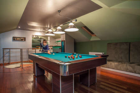 Travertine house - modern attic with billiards photo