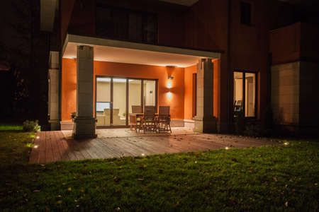 back light: Travertine house - illuminated patio with garden
