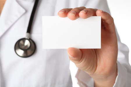 emergency number: Closeup of business card in doctor s hand