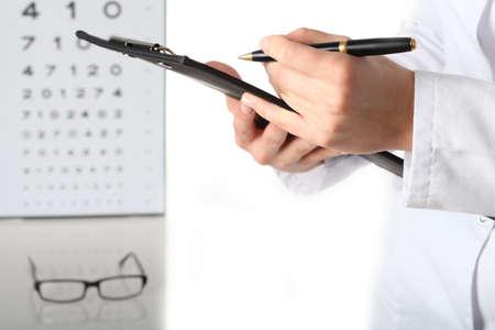 ophthalmologist: Optometrist with notes, examination, isolated white background Stock Photo