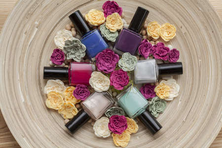 Six colorful nail polishes, bird eye view photo