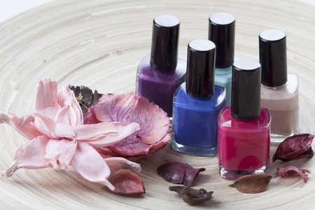 to lacquer: Colorful nail lacquer on a wooden plateau Stock Photo