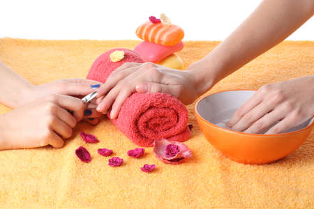 nail scissors: Cutting fingernails before doing french manicure Stock Photo