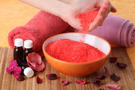 Bowl of cosmetic sea salt for manicure photo