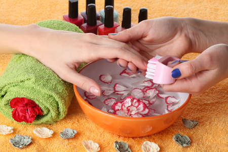 Beautician taking care of hands, beauty salon photo