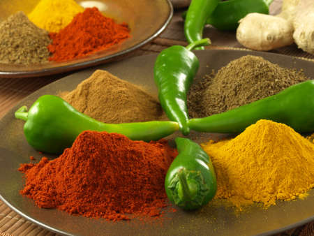 Colorful, hot spices for indian cuisine, closeup photo