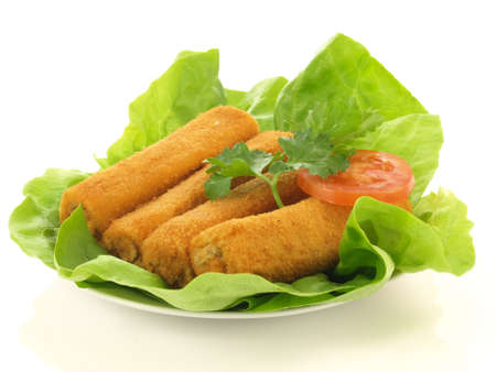 croquettes: Four croquettes on lettuce leaves on isolated background