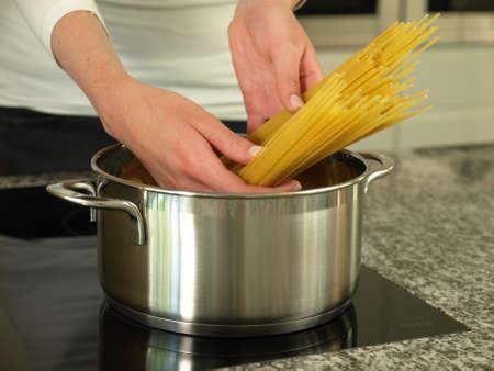 boiling: Boiling spaghetti pasta for delicious Italian dish Stock Photo