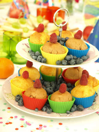comtemporary: Closeup of tasty muffins with raspberries and blueberries