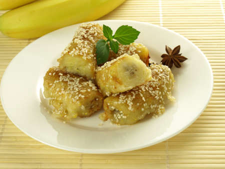 fritter: Banana fritters with sesame seeds, chinese dessert