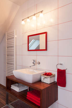 Ruby house - Red and white bathroom interior, modern equipment photo