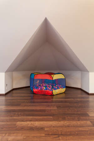 ruby house: Ruby house - Cosy little nook for children in the attic Stock Photo