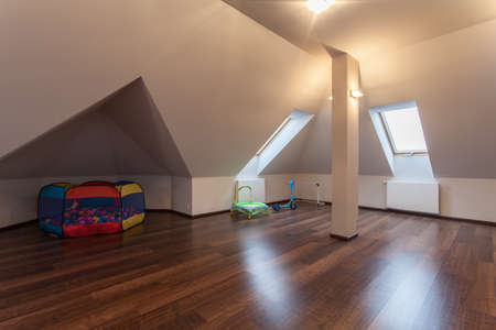 playpen: Ruby house - Modern and spacious attic with toys for children Stock Photo