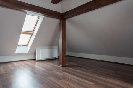 living room design: Ruby house - Empty loft with wooden floor and pillar, removal Stock Photo