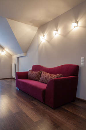 ruby house: Ruby house - Purple stylish couch in the attic of new house