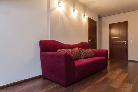ruby house: Ruby house - Big sofa on hallway in modern house
