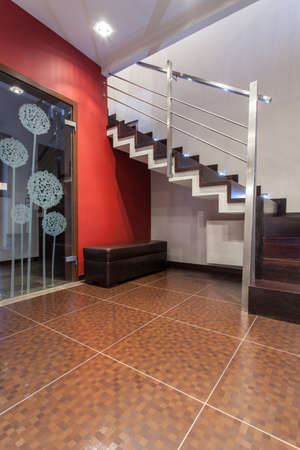 stair well: Ruby house - New stairs in elegant house, vertical view Stock Photo