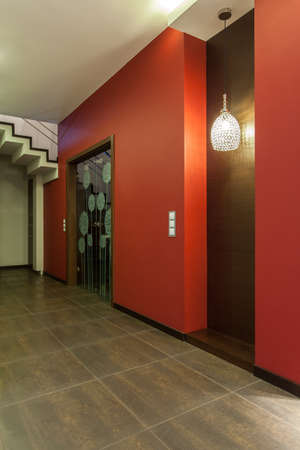 ruby house: Ruby house - Red walls in modern corridor in new house Stock Photo