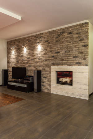 stone fireplace: Ruby house - Interior of new and modern living room