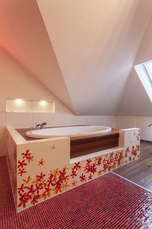 ruby house: Ruby house - White and red drop in bath in modern bathroom