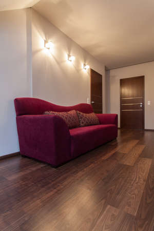 Ruby house - couch on hallway at a modern house photo