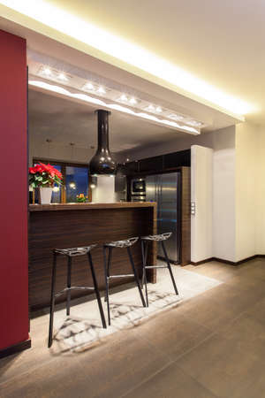 Ruby house - Kitchen counter with three tall bar stools photo