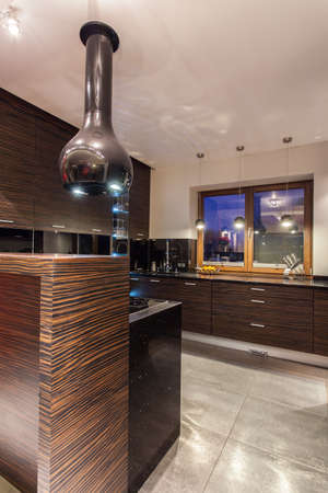ruby house: Ruby house - Interior of modern wooden kitchen with hood