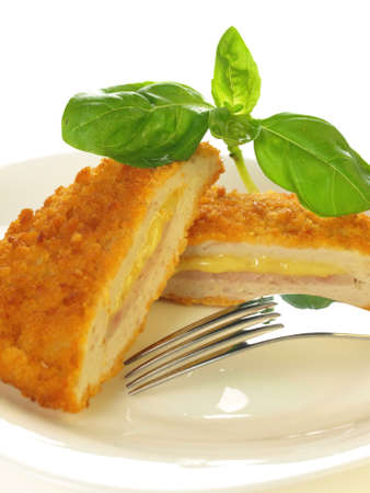 Stuffed cordon blue cutlet served on a plate on isolated background Stock Photo - 17178282