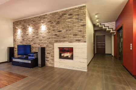 ruby house: Ruby house - Living room with fireplace and tv Stock Photo