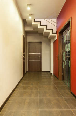 Ruby house - Corridor with ruby walls and patterned door photo