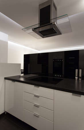 glass partition: Minimalist apartment - cooker in modern counter top; kitchen