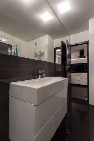 Minimalist apartment - bathroom interior with open door photo
