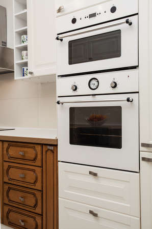 Cloudy home - kitchen appliances- oven and microwave Stock Photo - 17317894