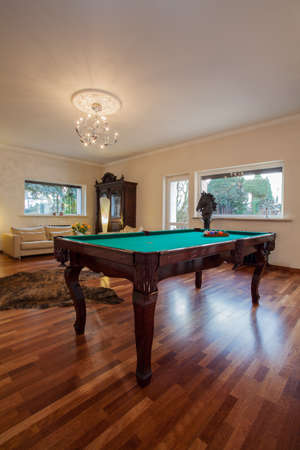 snooker room: Cloudy home - classic billiard table in stylish house