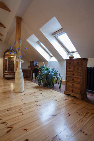 Cloudy home - attic with a pine wood floor and wooden furniture photo