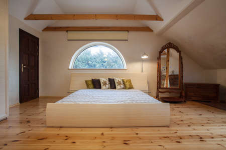 Cloudy home - bright bedroom interior in the attic photo