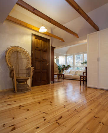 Cloudy home - room with a wooden floor and armchair photo