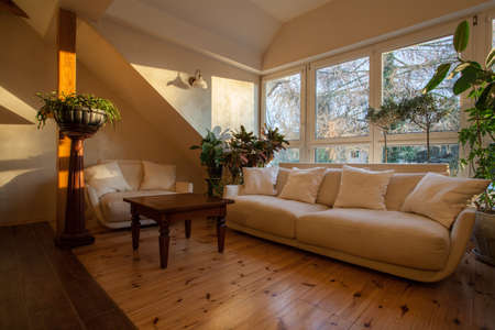 cloudy home: Cloudy home - bright and huge couch on the attic Stock Photo