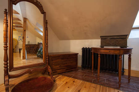 Cloudy home - old fashioned furniture, a huge mirror photo