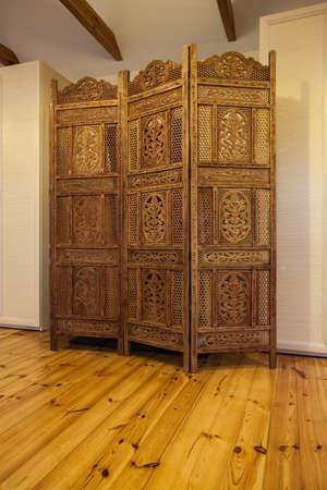 Cloudy home - wooden beautiful openwork screen in bedroom Stock Photo - 17495281
