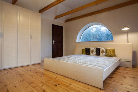 Cloudy home - bright bedroom interior, horizontal view photo